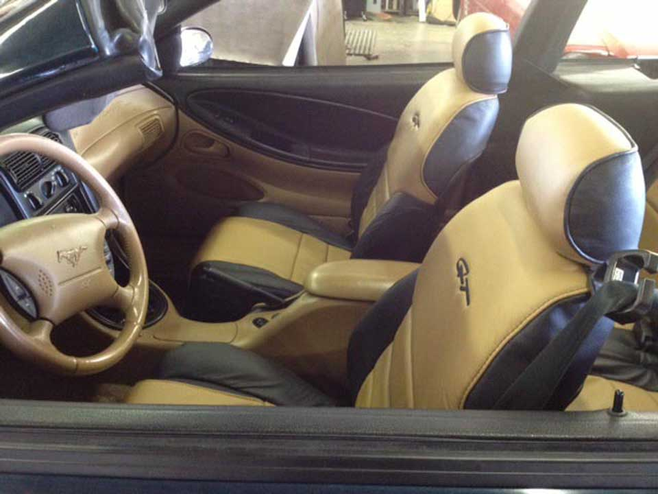 brown and black leather car seat cover