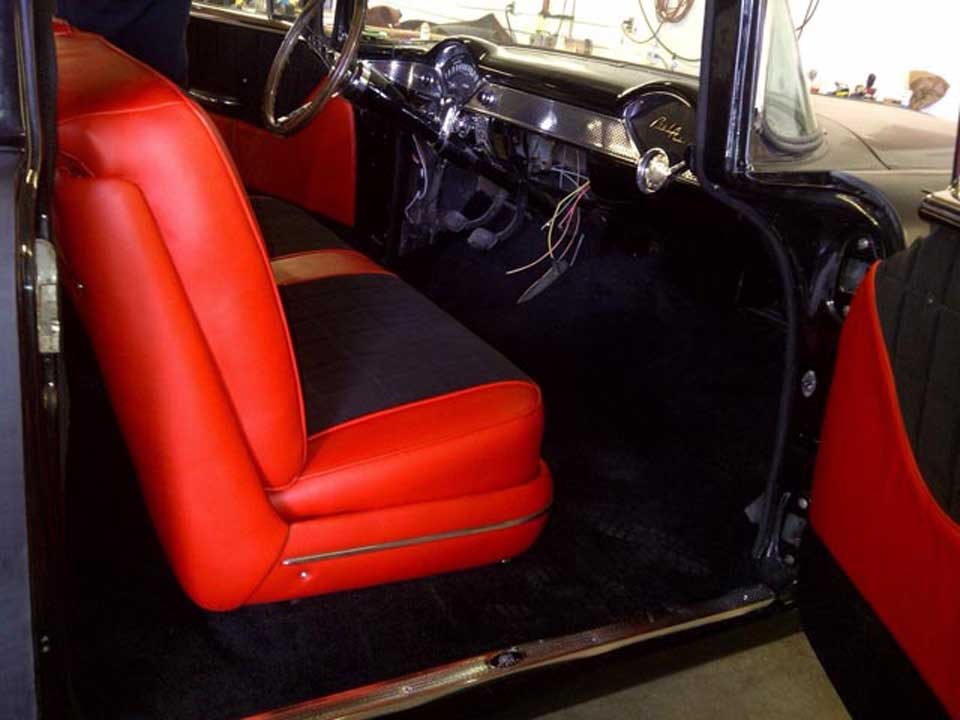 side view of a red colour car seat cover