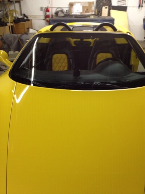 front view of a yellow colour car